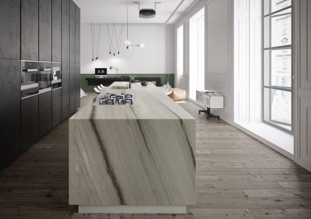 Cocina concepto abierto a salón con isla de cuarcita Naturamia® Metallo