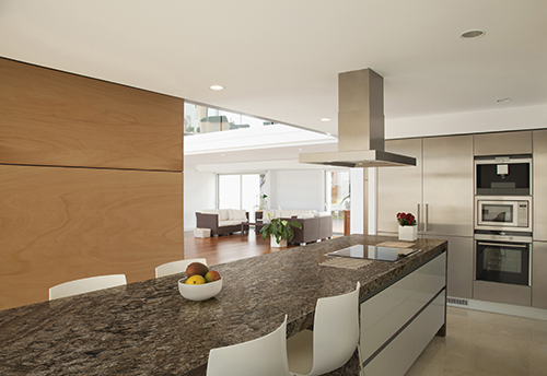 Open space kitchen with warm lighting are trend in 2020